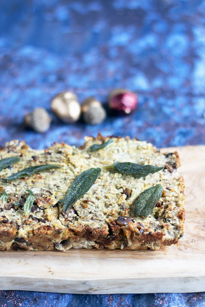 Parsnip and chestnut nut roast on board with sage leaves