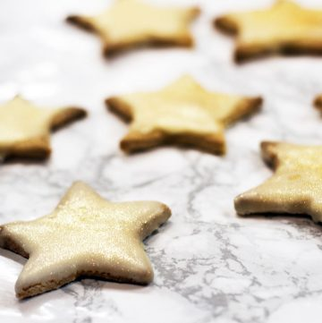 gingerbread stars on white marble background