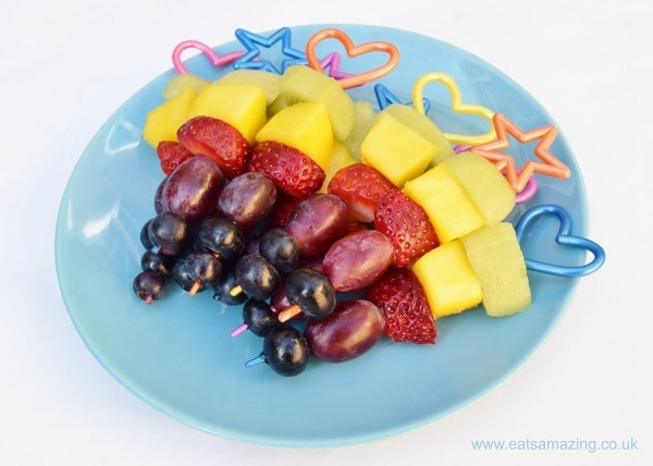 fruit skewers on blue plate