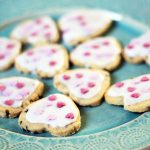vegan shortbread biscuit hearts on green plate