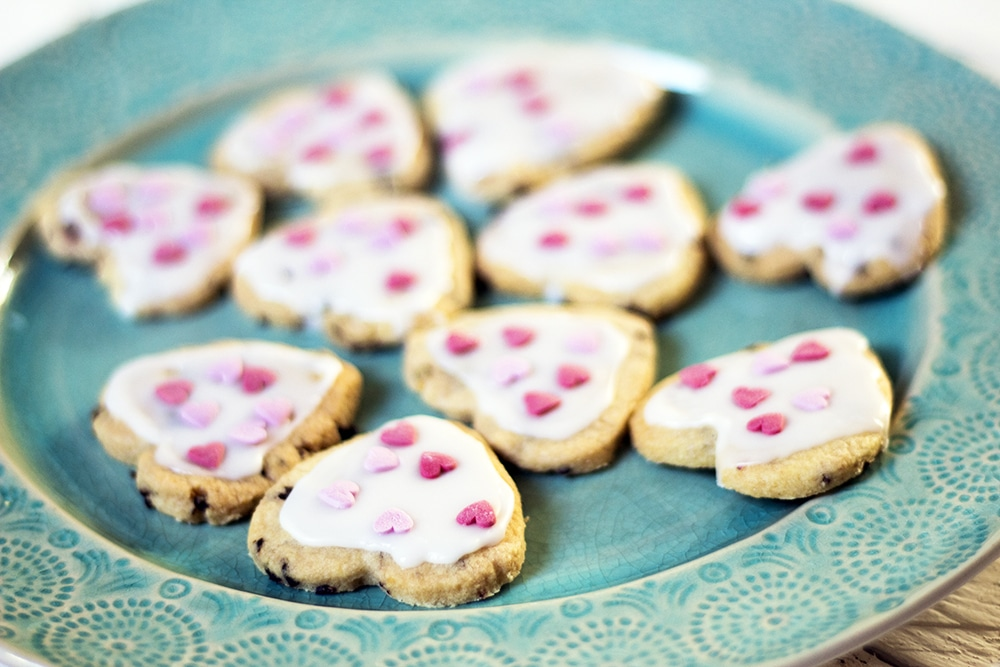 vegan shortbread biscuit hearts on green plate