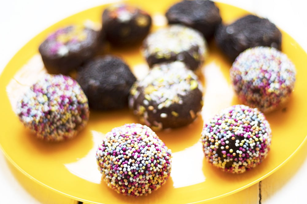 healthy cake pops on yellow plate