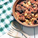 vegetarian meatballs made with aubergine in dish with gnocchi and olives