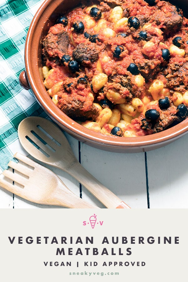 aubergine meatballs for vegetarians and vegans in dish with gnocchi, olives and tomato sauce
