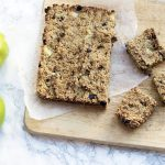 refined sugar free flapjacks on board with two cooking apples