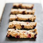 banana blueberry buckwheat bars on black slate plate