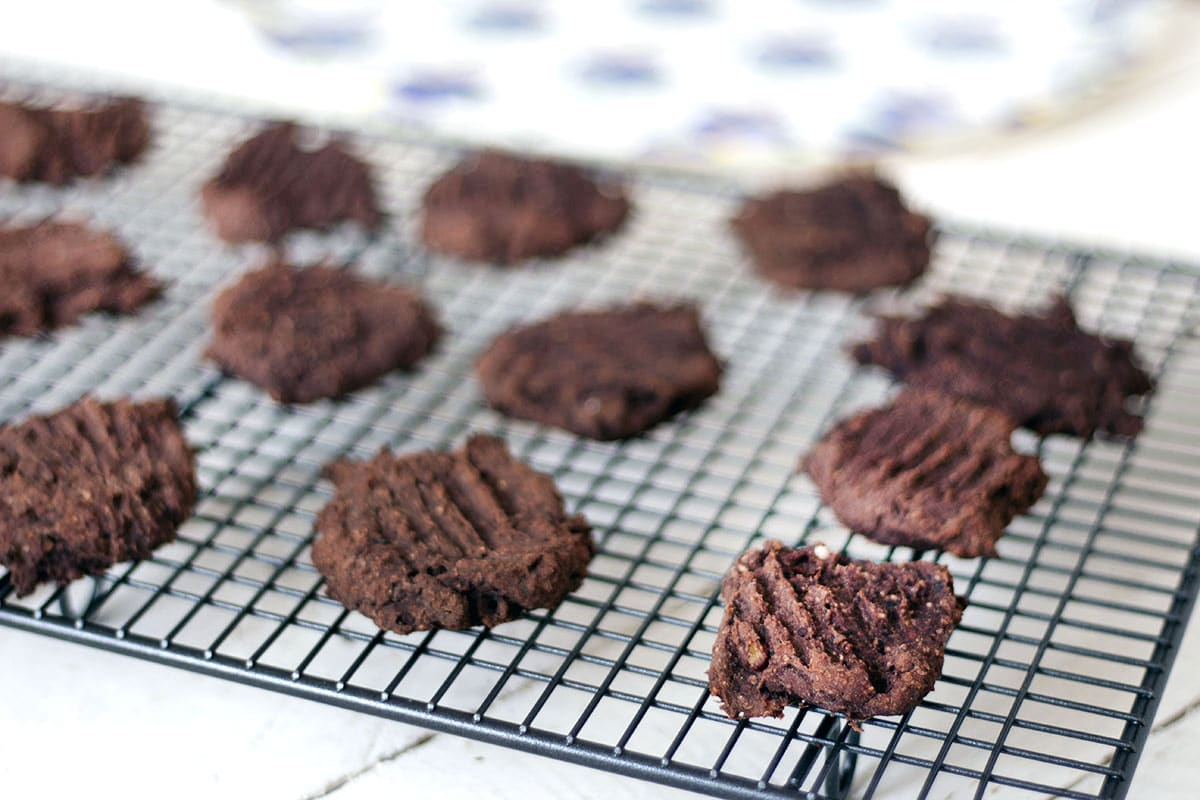 close up of black bean cookies on cooling rack