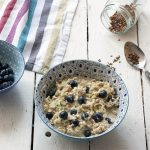 Healthy overnight oats with courgette (zucchini), lemon and blueberry