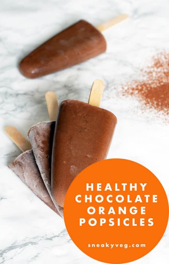 orange chocolate popsicles on white background