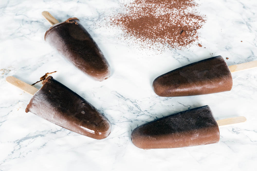 Healthy chocolate ice lollies with orange and sweet potato