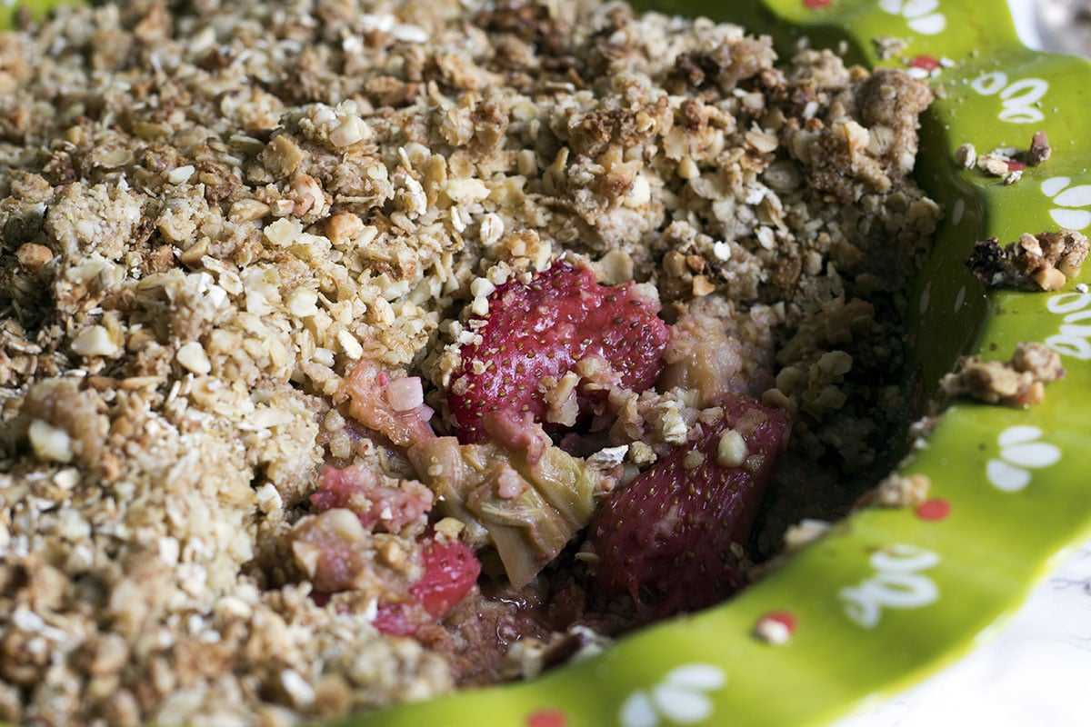 close up of strawberry and rhubarb crumble