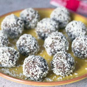 coconut snowballs on yellow plate