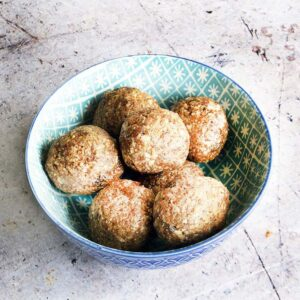fig and apple energy balls in blue bowl