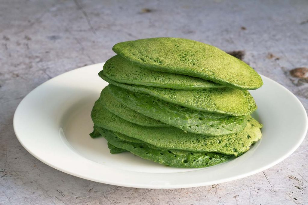 spinach pancakes on white plate
