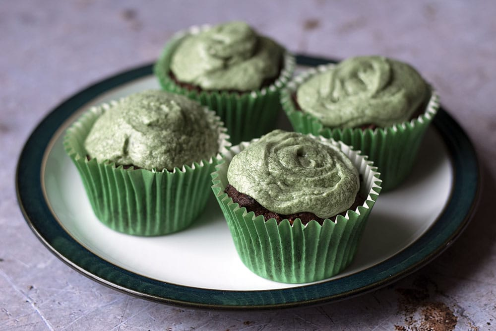 Cupcakes coloured with natural spirulina buttercream