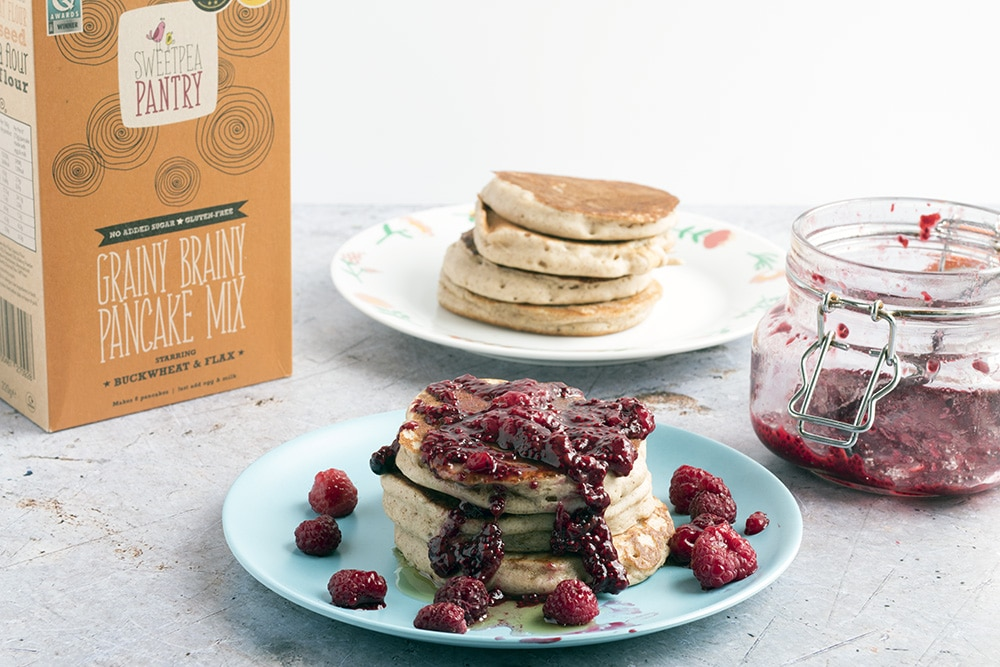 banana almond butter pancakes with berry chia jam