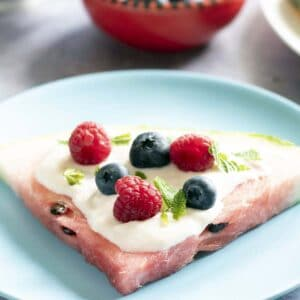 slice of watermelon pizza on blue plate