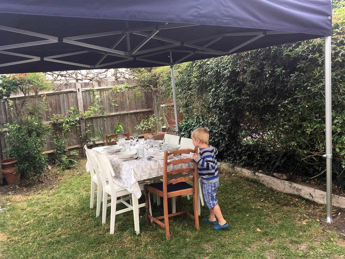 la belle assiette review - little S looking at table in garden before dinner
