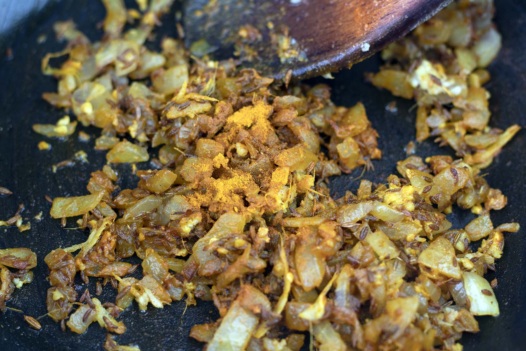 turmeric in pan with onions