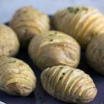 easy hasselback potatoes recipe by Sneaky Veg. Suitable for vegans.
