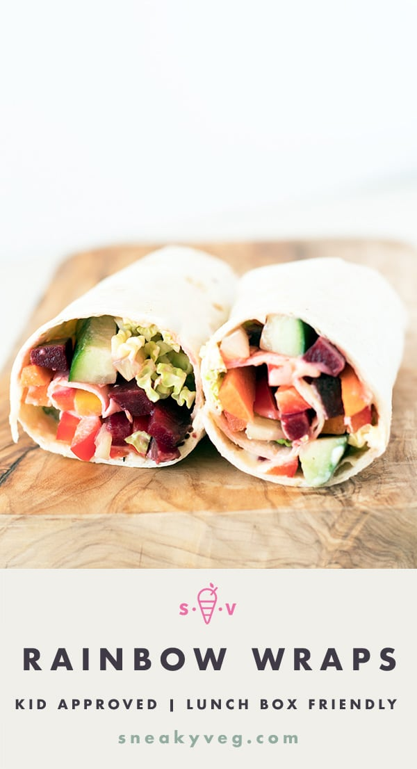 tortilla wraps for lunchbox with rainbow vegetables on wooden board