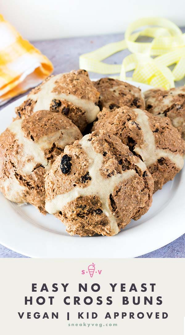 easy hot cross buns on white plate with yellow background