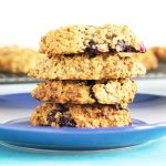 blueberry and peanut butter cookies stacked up on blue plate