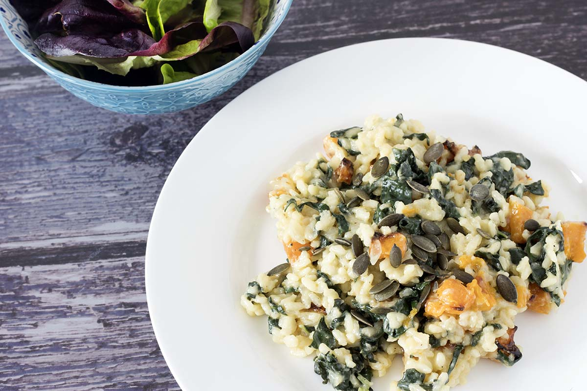 kale risotto with butternut squash and bowl of salad