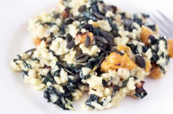 vegan risotto with kale and butternut squash on white plate