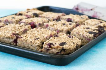 blueberry baked flapjack bars on baking tray