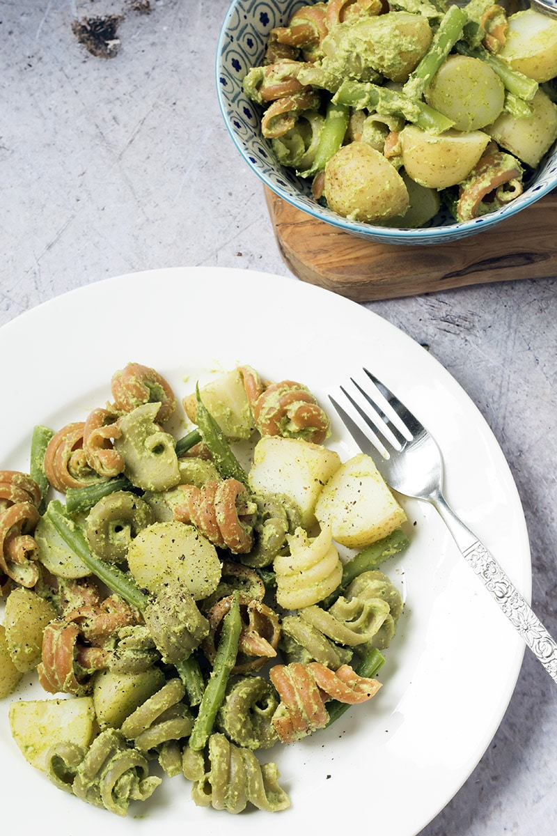broccoli pesto with green beans and new potatoes (vegan) on white plate