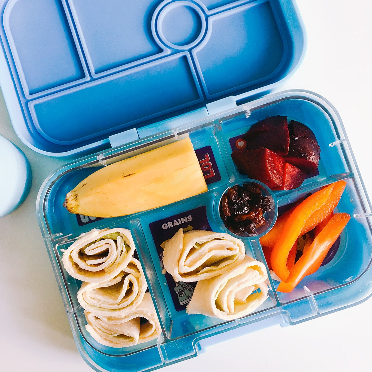 blue Yumbox filled with healthy foods - healthy lunchbox ideas by Sneaky Veg