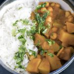 close up shot of potato and chickpea curry recipe in bowl