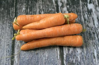 carrots on wooden background