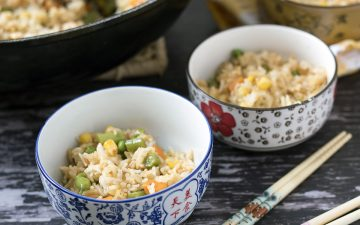 veggie fried rice in bowls with child's chopsticks