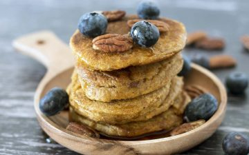 butternut squash pancakes in stack with blueberries and pecans