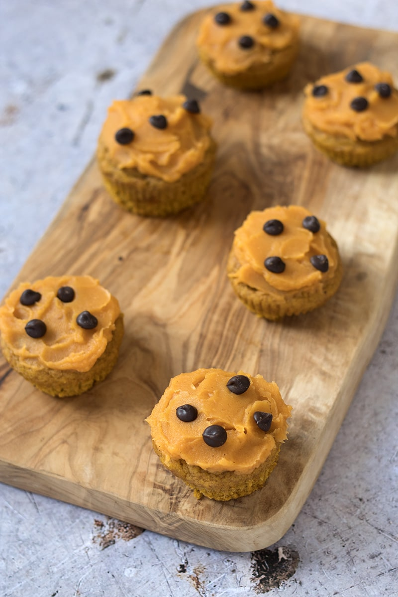 pumpkin muffins on wooden board