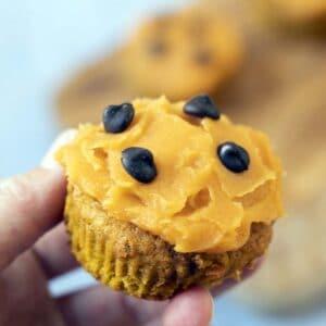 hand holding pumpkin muffin