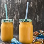 carrot smoothie in two smoothie jars