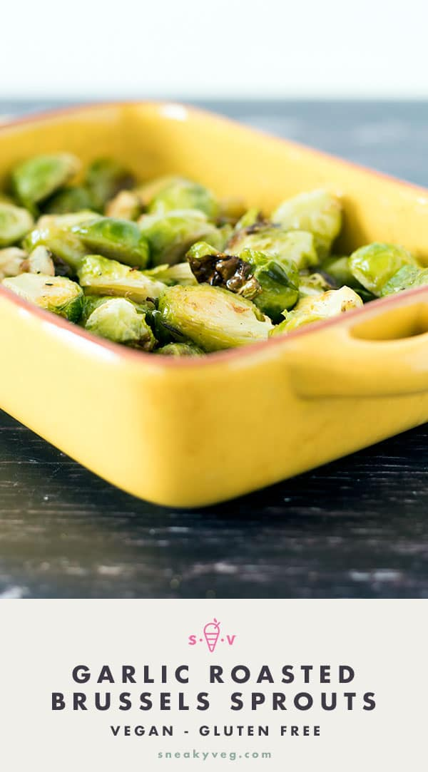 garlic roasted brussels sprouts in yellow dish on wood background