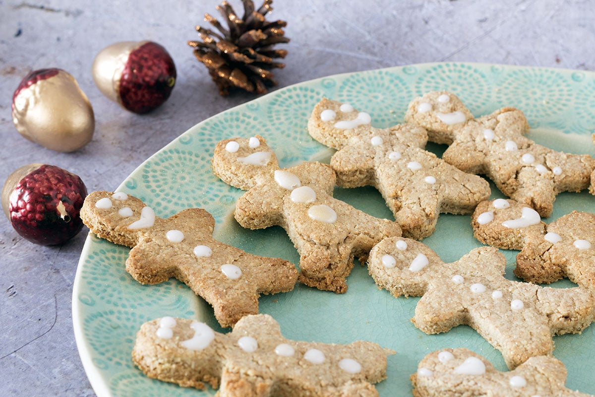 healthy vegan gingerbread men on light green plate