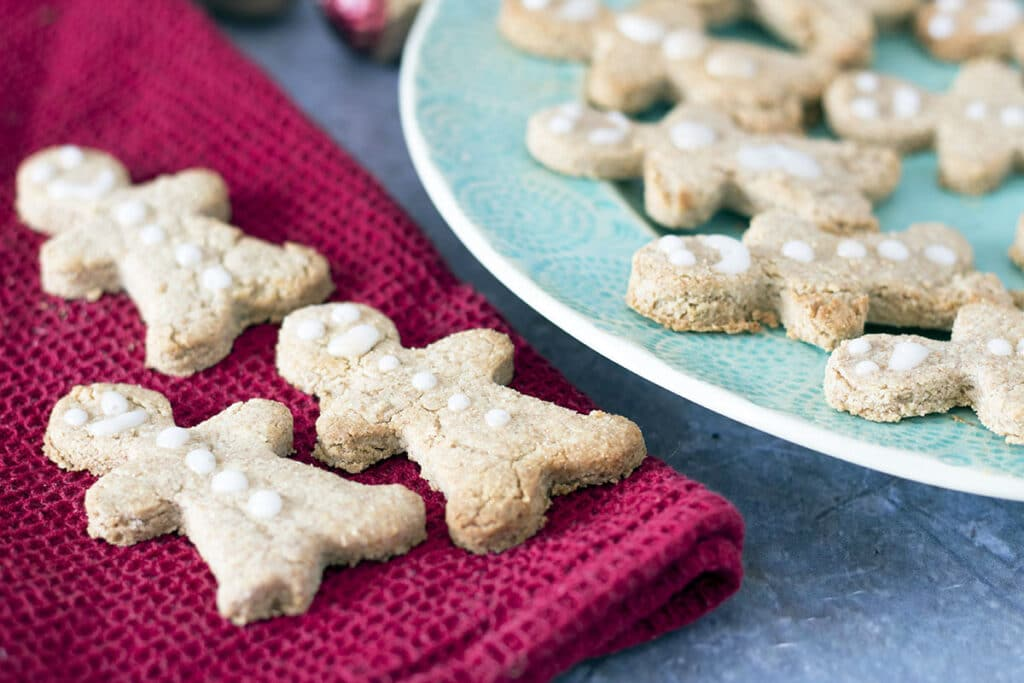 plate of gingerbread men with three on red napkin