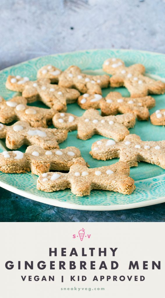 healthy vegan gingerbread men on green plate