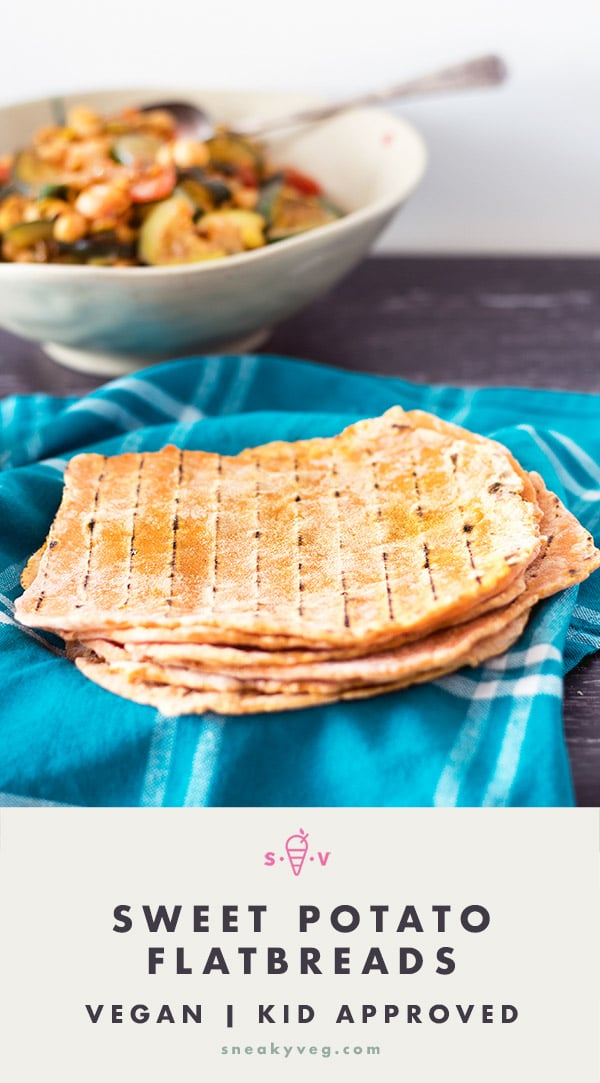 sweet potato flatbreads on blue cloth with curry in background