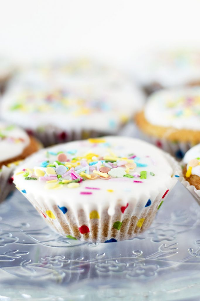 vegan cupcakes with white icing and sprinkles