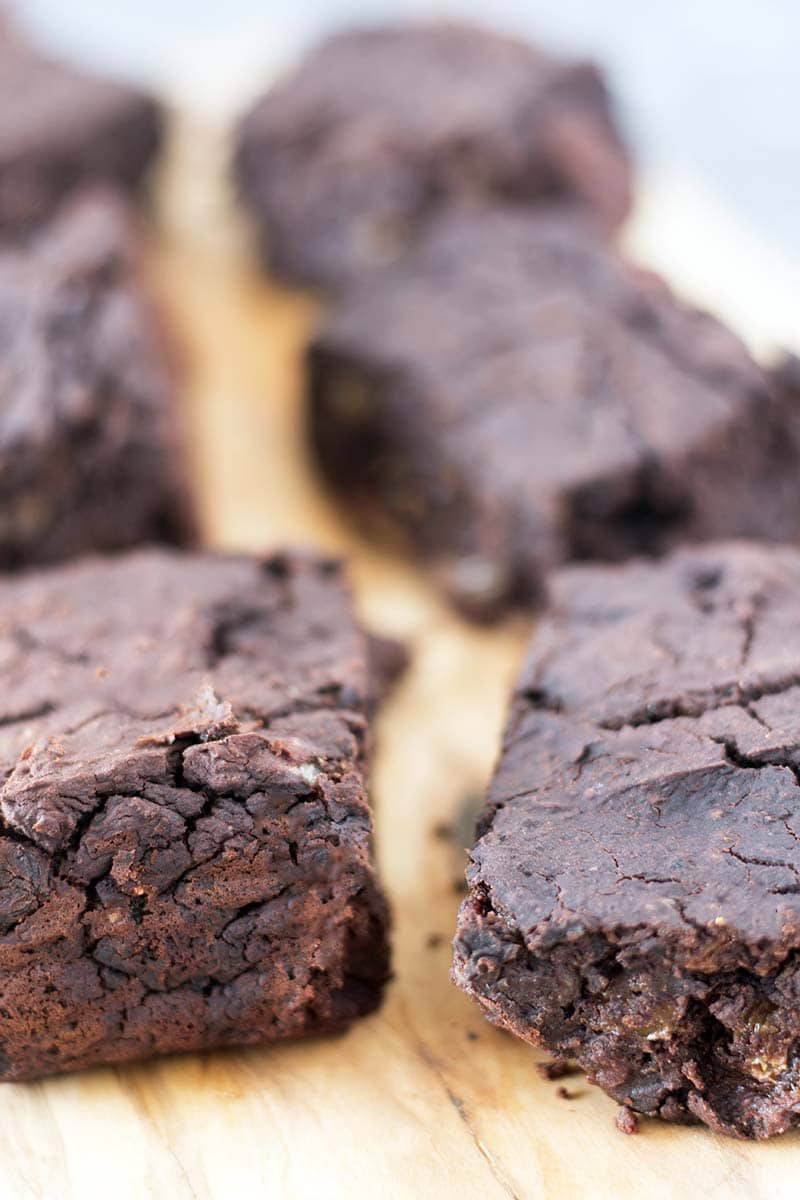 close up of vegan black bean brownies on board