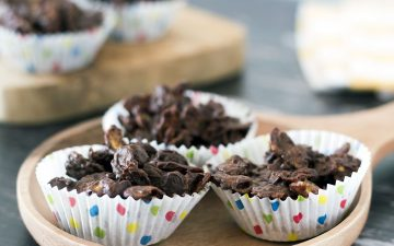 healthier chocolate cornflake cakes on wooden plate