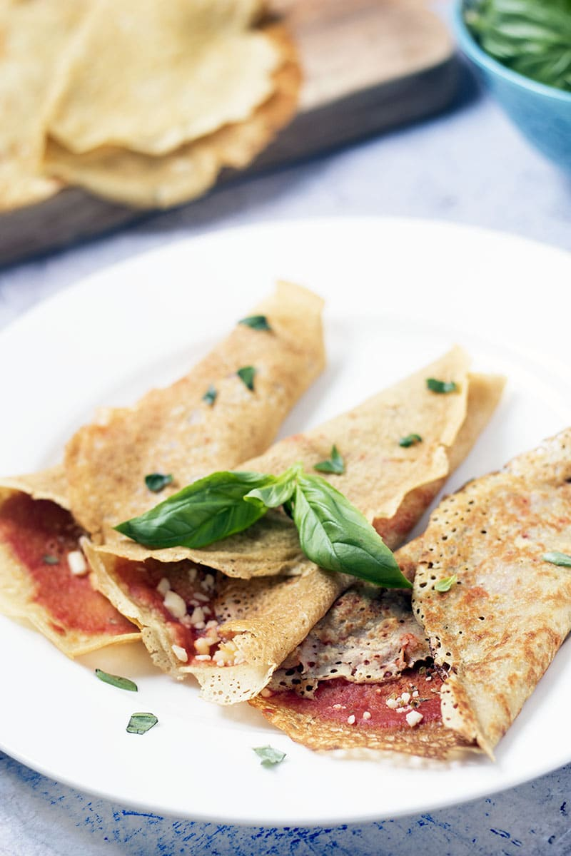pizza crepes with basil and extra crepes in background