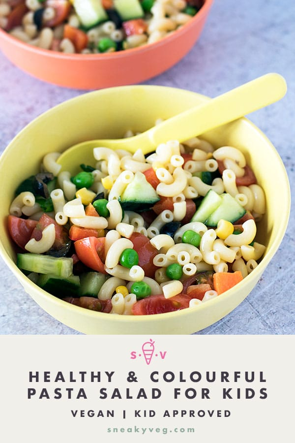 kids pasta salad in yellow and orange bowls