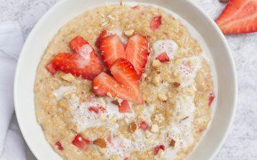 strawberry porridge in white bowl